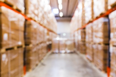 Photo for logistic, storage, shipment, industry and manufacturing concept - cargo boxes storing at warehouse shelves bokeh - Royalty Free Image