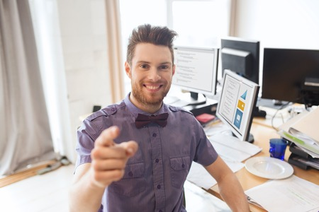 Photo for business, startup, hiring, gesture and people concept - happy businessman or creative male office worker with computers pointing finger at you - Royalty Free Image