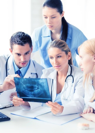 Photo pour picture of young group of doctors looking at x-ray - image libre de droit