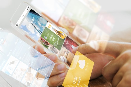 Photo pour business, technology, mass media and people concept - close up of male hand holding transparent smartphone with internet news web page on screen - image libre de droit