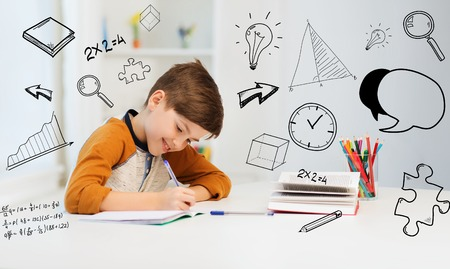 Photo pour education, childhood, people, homework and school concept - smiling student boy with book writing to notebook at home over mathematical doodles - image libre de droit