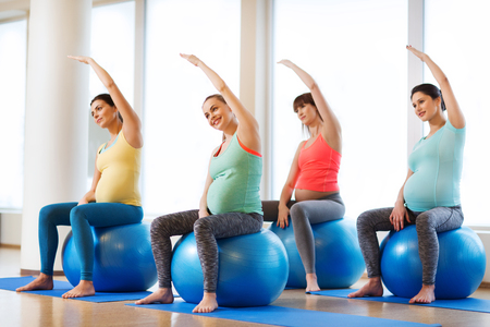 Photo for pregnancy, sport, fitness, people and healthy lifestyle concept - group of happy pregnant women exercising on ball in gym - Royalty Free Image