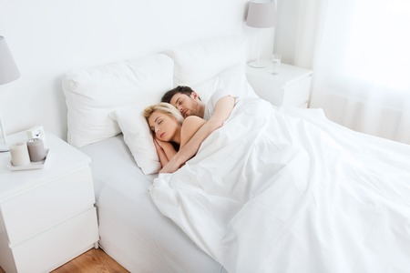 Photo pour people, rest and relationships concept - happy couple sleeping in bed at home - image libre de droit