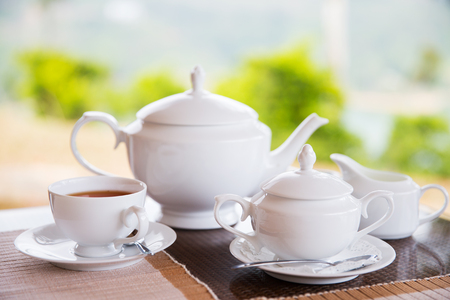 Photo pour teatime, drink and object concept - close up of tea service on table at restaurant or teahouse - image libre de droit