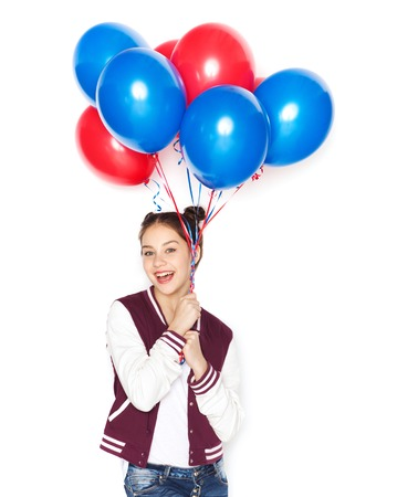 people, teens, holidays and party concept - happy smiling pretty teenage girl with helium balloons