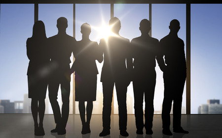 Photo pour business, teamwork and people concept - business people silhouettes over office background - image libre de droit