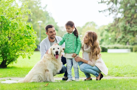 Photo for family, pet, domestic animal and people concept - happy family with labrador retriever dog on walk in summer park - Royalty Free Image