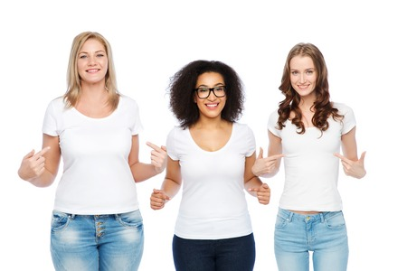 Photo pour friendship, diverse, body positive and people concept - group of happy different size women in white t-shirts pointing finger to themselves - image libre de droit
