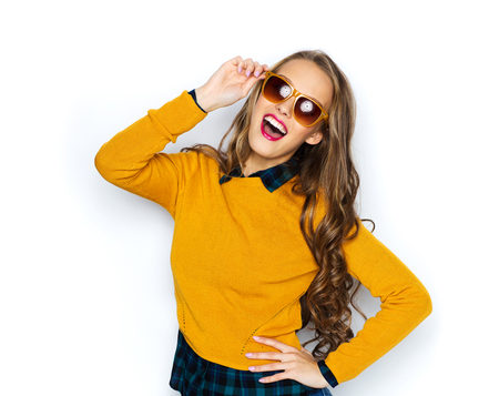 Photo pour people, style and fashion concept - happy young woman or teen girl in casual clothes and sunglasses having fun - image libre de droit