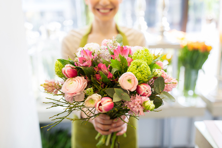 Photo for people, business, sale and floristry concept - close up of florist woman holding bunch at flower shop - Royalty Free Image