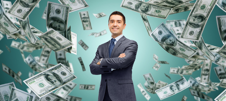 Photo for business, finance, investment, economy and people concept - happy businessman over dollar cash money rain and green background - Royalty Free Image