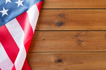american independence day, patriotism and nationalism concept - close up of american flag on wooden boards