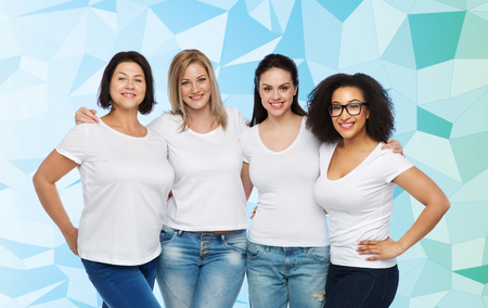 Photo pour friendship, diverse, body positive and people concept - group of happy different size women in white t-shirts hugging over blue low poly background - image libre de droit