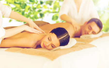 Photo for picture of couple in spa salon getting massage - Royalty Free Image