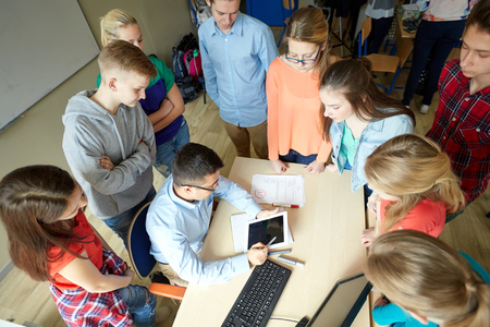 Photo pour education, learning, teaching, technology and people concept - group of students and teacher with tablet pc computer at school - image libre de droit