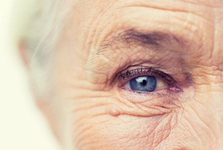 Photo pour age, vision and old people concept - close up of senior woman face and eye - image libre de droit