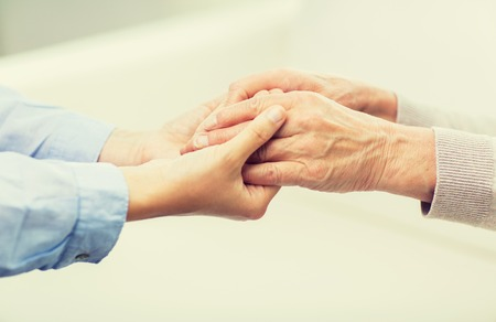 Photo pour people, age, family, care and support concept - close up of senior and young woman  holding hands - image libre de droit