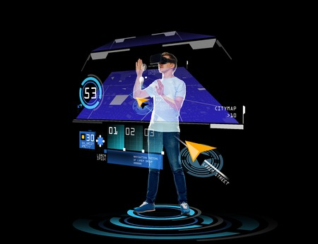 Photo pour 3d technology, augmented reality, gaming, cyberspace and people concept - happy young man in virtual reality headset or 3d glasses with gps navigator projection over black background - image libre de droit