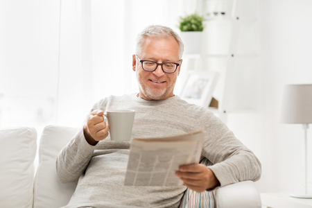 Photo for leisure, information, people and mass media concept - senior man in glasses reading newspaper at home - Royalty Free Image