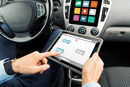 Photo pour transport, business trip, technology, online communication and people concept - close up of male hands holding tablet pc computer with messenger on screen in car - image libre de droit