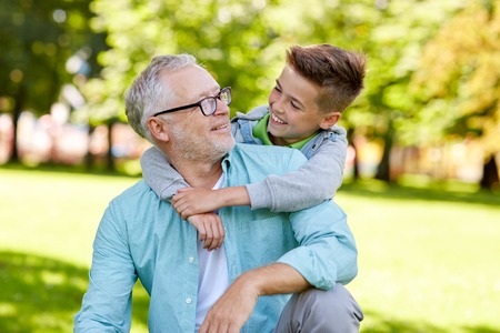 Photo pour family, generation, relations and people concept - happy grandfather and grandson hugging at summer park - image libre de droit