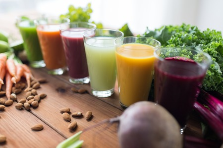 Photo pour healthy eating, drinks, diet and detox concept - glasses with different fruit or vegetable juices and food on table - image libre de droit