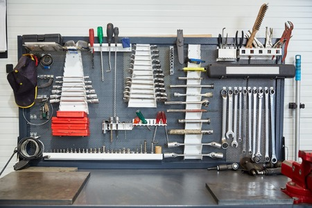 car service, repair, maintenance and instruments concept - tools set at car workshop