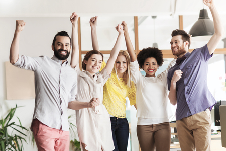 Photo pour business, triumph, gesture, people and teamwork concept - happy international creative team raising hands up and celebrating victory in office - image libre de droit