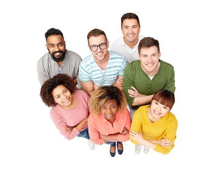 Photo pour diversity, race, ethnicity and people concept - international group of happy smiling men and women over white - image libre de droit
