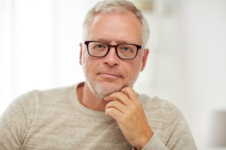 Photo pour old age, problem and people concept - close up of senior man in glasses thinking - image libre de droit