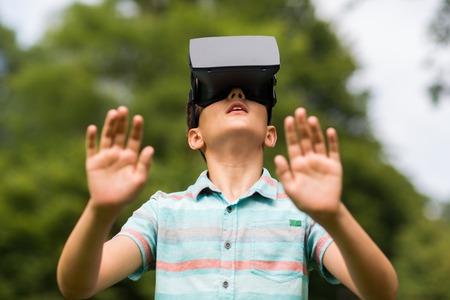 Photo pour boy with virtual reality headset outdoors - image libre de droit