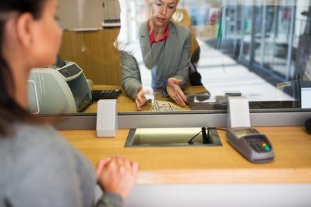 Photo pour clerk with cash money and customer at bank office - image libre de droit