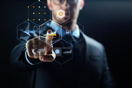 Photo pour close up of businessman with virtual charts - image libre de droit
