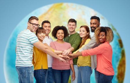 Photo pour international group of happy people holding hands - image libre de droit