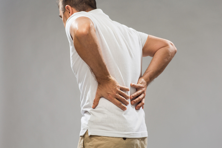 Foto de close up of man suffering from backache - Imagen libre de derechos