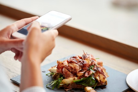 Photo for hands with smartphone photographing food - Royalty Free Image