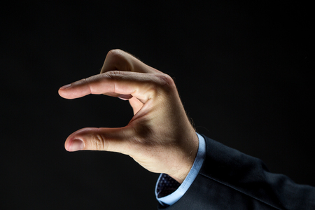 Photo pour close up of businessman hand showing small size - image libre de droit