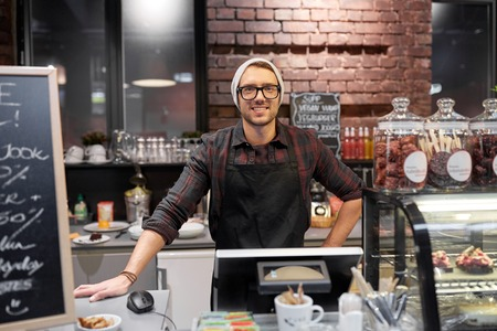 Photo pour happy seller man or barman at cafe counter - image libre de droit