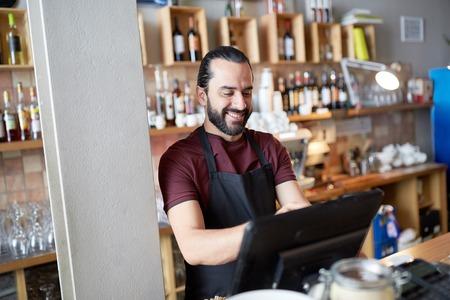 Photo for happy man or waiter at bar cashbox - Royalty Free Image