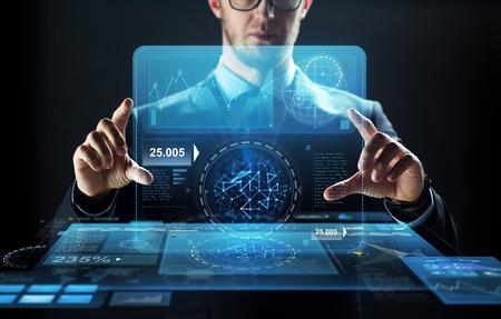 Photo pour close up of businessman with virtual screen - image libre de droit