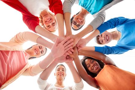 Foto de international group of women with hands together - Imagen libre de derechos