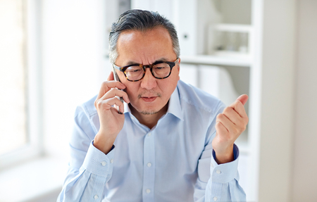 Photo for business, people, communication and technology concept - serious asian businessman calling on smartphone in office - Royalty Free Image