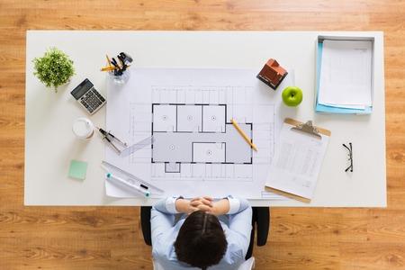 Foto de architect with house blueprint at office - Imagen libre de derechos