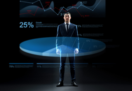 businessman in suit with virtual chart hologram
