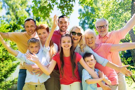 Foto de happy family portrait in summer garden - Imagen libre de derechos
