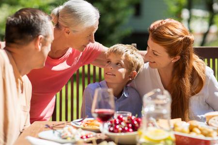 Photo pour happy family having dinner or summer garden party - image libre de droit