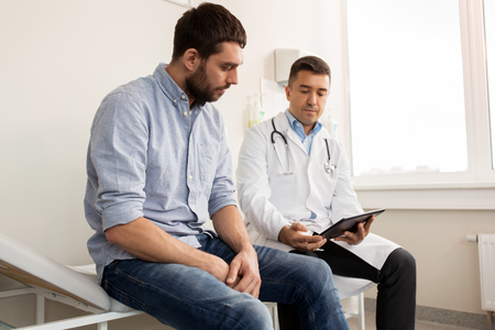 Photo pour doctor and man with health problem at hospital - image libre de droit