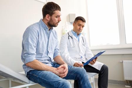 Photo pour doctor and man with health problem at hospital - image libre de droit