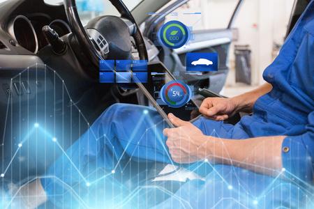 Photo pour mechanic man with tablet pc making car diagnostic - image libre de droit