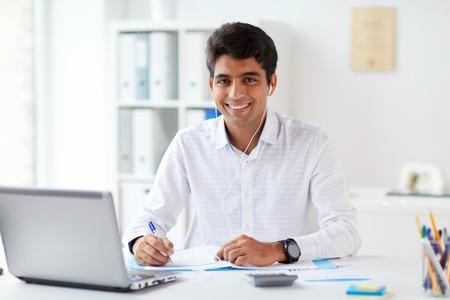 Photo pour businessman in earphones working at office - image libre de droit